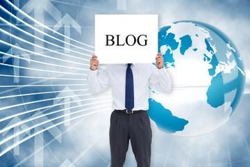 Businessman holding card saying blog