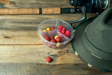 baits, fishing rod and hat