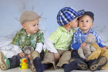 Boy kissing his brother
