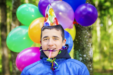 Teenager with balloons in birthday party at outdoors