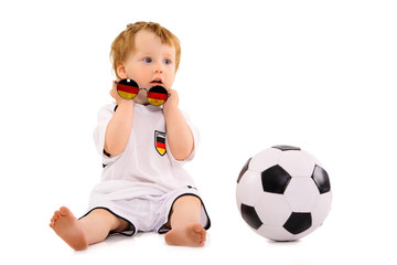 baby soccer fan has a lot of fun