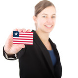 business woman holding a card with the flag of Liberia