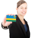 business woman holding a card with the flag of Rwanda