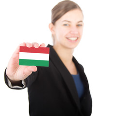 business woman holding a card with the flag of Hungary
