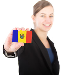 business woman holding a card with the flag of Moldova