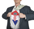 Businessman showing Croatia flag superhero suit underneath his s