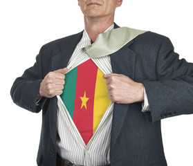 Businessman showing Cameroon flag superhero suit underneath his
