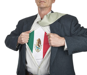 Businessman showing Mexico flag superhero suit underneath his sh