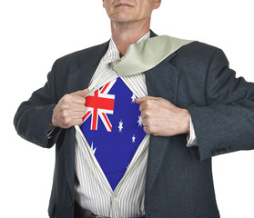 Businessman showing Australia flag superhero suit underneath his