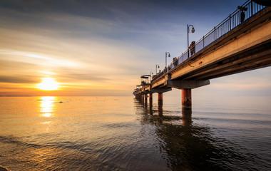 Sunset and pier in Miedzyzdroje