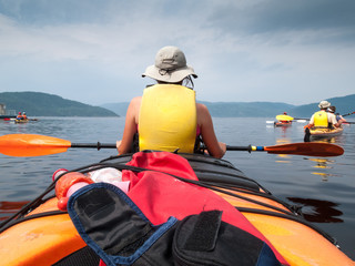 Tourists kayaking in river, Quebec, Canada