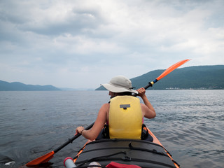Tourist kayaking in a river, Quebec, Canada