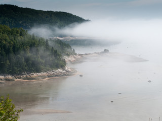 Fog over river, Quebec, Canada