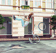 girl falling off her bicycle