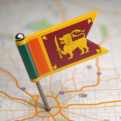 Sri Lanka Small Flag on a Map Background.