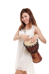 Asian woman playing a djembe