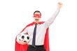 Man in superhero costume holding a football