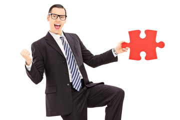 Happy businessman found the missing piece of a puzzle