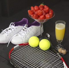 Tennis and strawberries with a glass of fizz