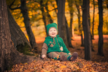 funny laughing boy at fall forets
