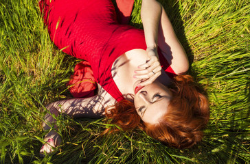 beautiful red haired woman enjoying life