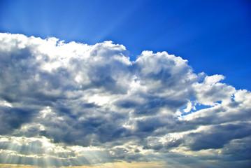 """The sun's rays breaking through the dark rain clouds"""