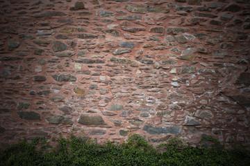 Hintergrund rote Naturstein Mauer