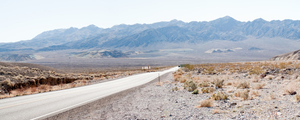 Straight road passing through landscape, Death Valley National P