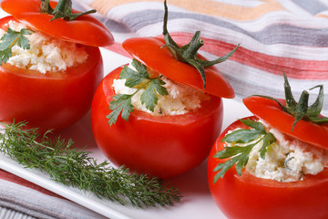 Fresh red tomatoes filled with soft cheese and herbs