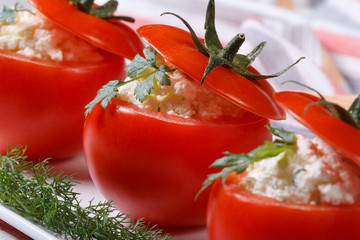 Tasty appetizer of fresh tomatoes with cheese and herbs