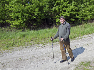 The senior man by nordic walking in Little Carpathians mountain,