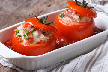 baked tomatoes stuffed with rice, vegetables and meat