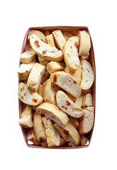 Cantuccini with peanuts, dried apricots and raisins in a basket