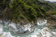 Постер, плакат: Pavilion on top of a cliff mountains ravine & river at Taroko