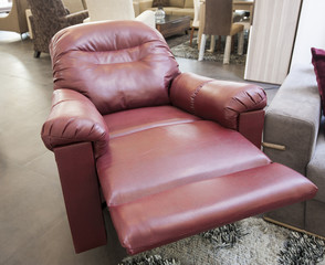 Red leather armchair in show room