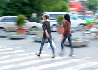 Busy city street women on zebra crossing