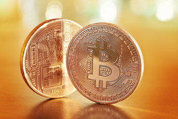 Golden Bitcoins on a gold background (new virtual money )