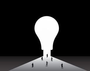 Business men and women standing front of big idea lightbulb door