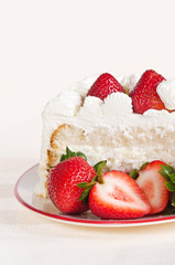Slice of homemade strawberry cream cake