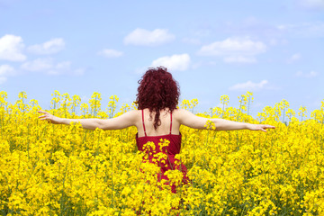Woman enjoying in a rape field