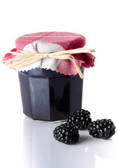 Jar of blackberry jam with fresh blackberries