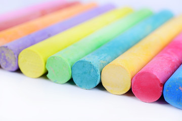 closeup colored chalk arranged