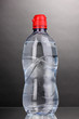 plastic bottle of water on grey background
