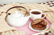 Cup and teapot with cookies