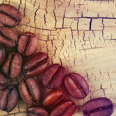 Coffee Beans on Old Wooden Background.