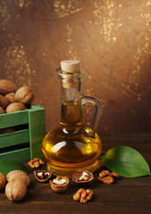 Walnut oil and nuts on wooden table