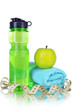 Sports bottle, apple,towel and measuring tape on grey