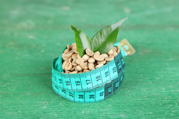 Raw green coffee beans and measuring tape,