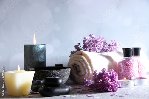 Composition with spa treatment, towels and lilac flowers,
