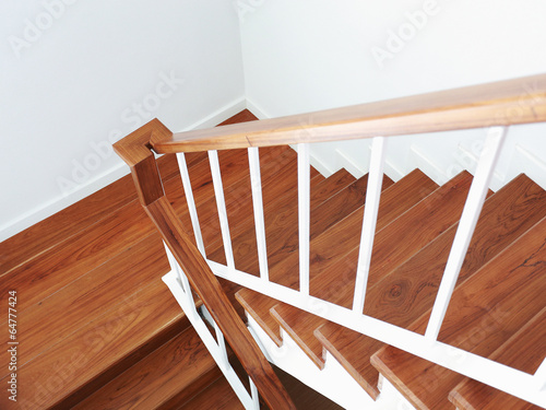 wooden staircase in a white modern house - 64777424